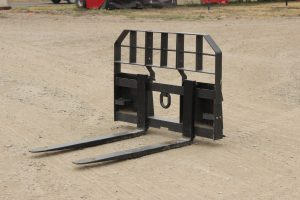 Skid steer style HD pallet fork for sale in Lethbridge, Alberta. Skidsteer attachments for sale in Lethbridge, Alberta. Skidsteer pallet forks available at Hanlon Ag Centre.