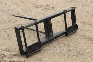 Skidsteer mount round bale fork for sale in Lethbridge, Alberta. Skid steer mount round bale fork available at Hanlon Ag Centre.